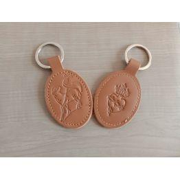 porte-clés en cuir marron avec motif Agneau et Sacré-Coeur de Petite maroquinerie